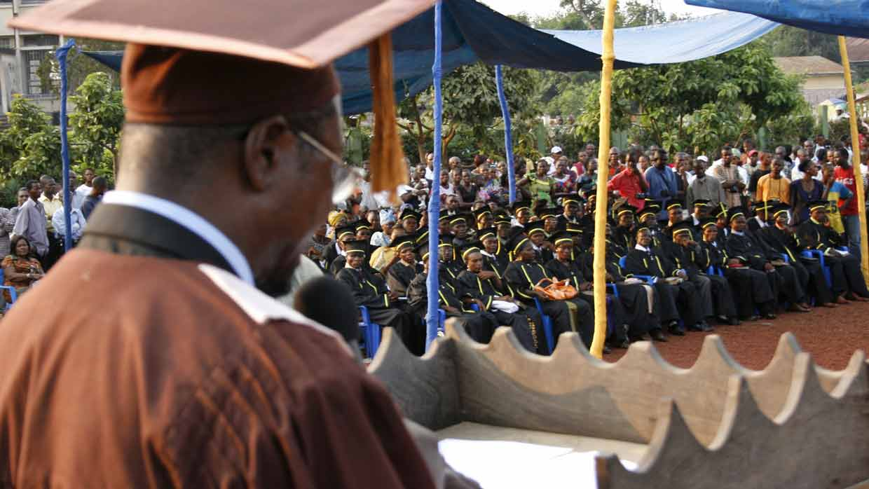 Bible school director addressing graduates