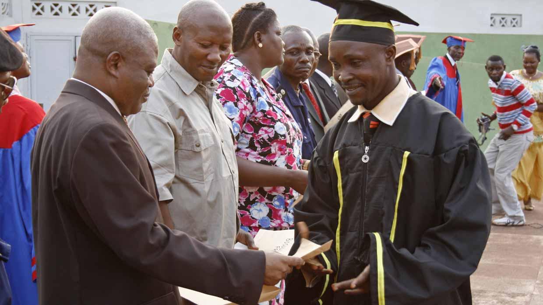 Mbandaka graduate receiving diploma